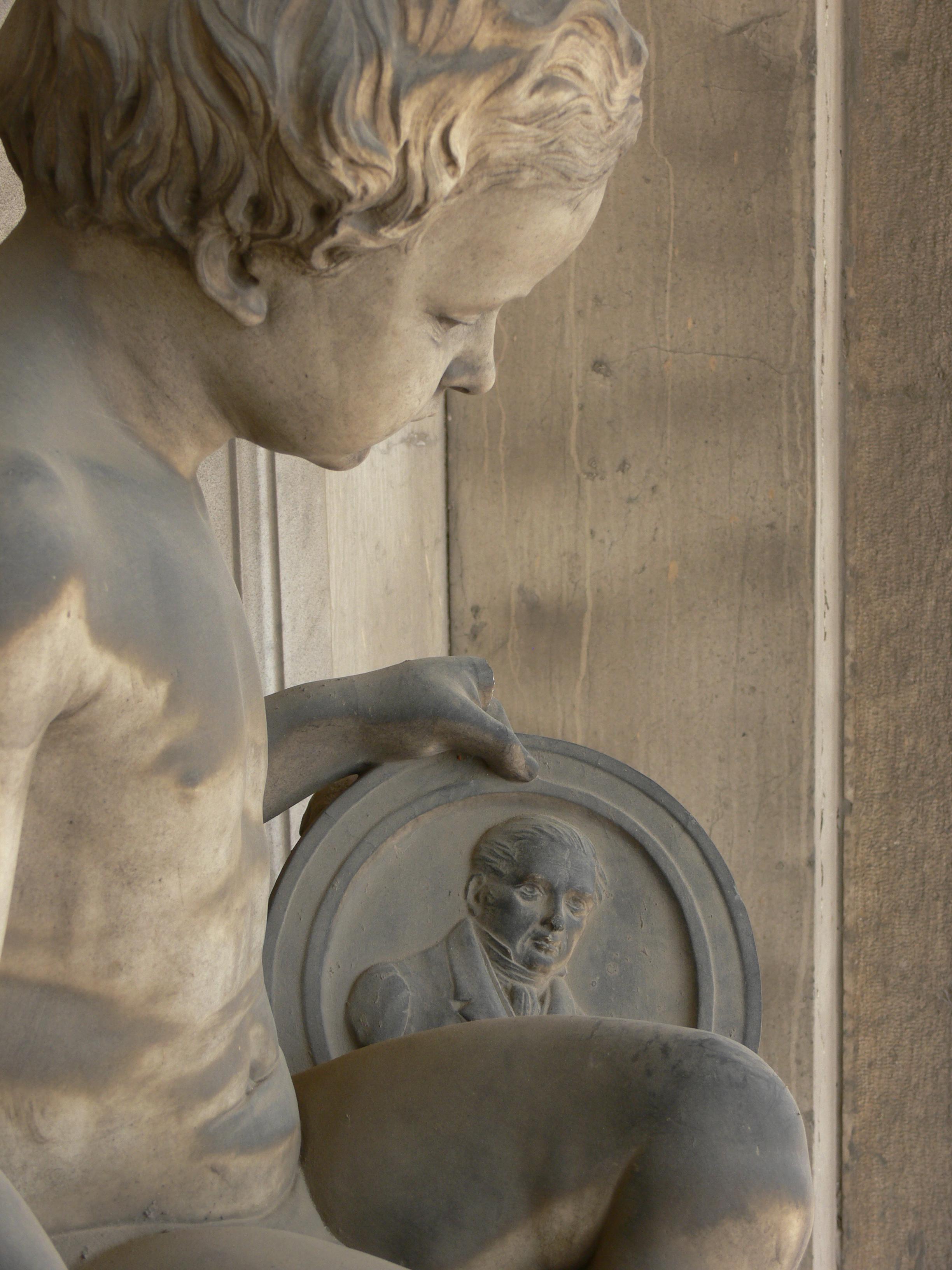 G.B. Lombardi, Monumento funebre della famiglia Mazzuchelli (part.), 1850-51, marmo di Carrara, brescia, Cimitero Vantiniano, portico terzo, arcata quarta