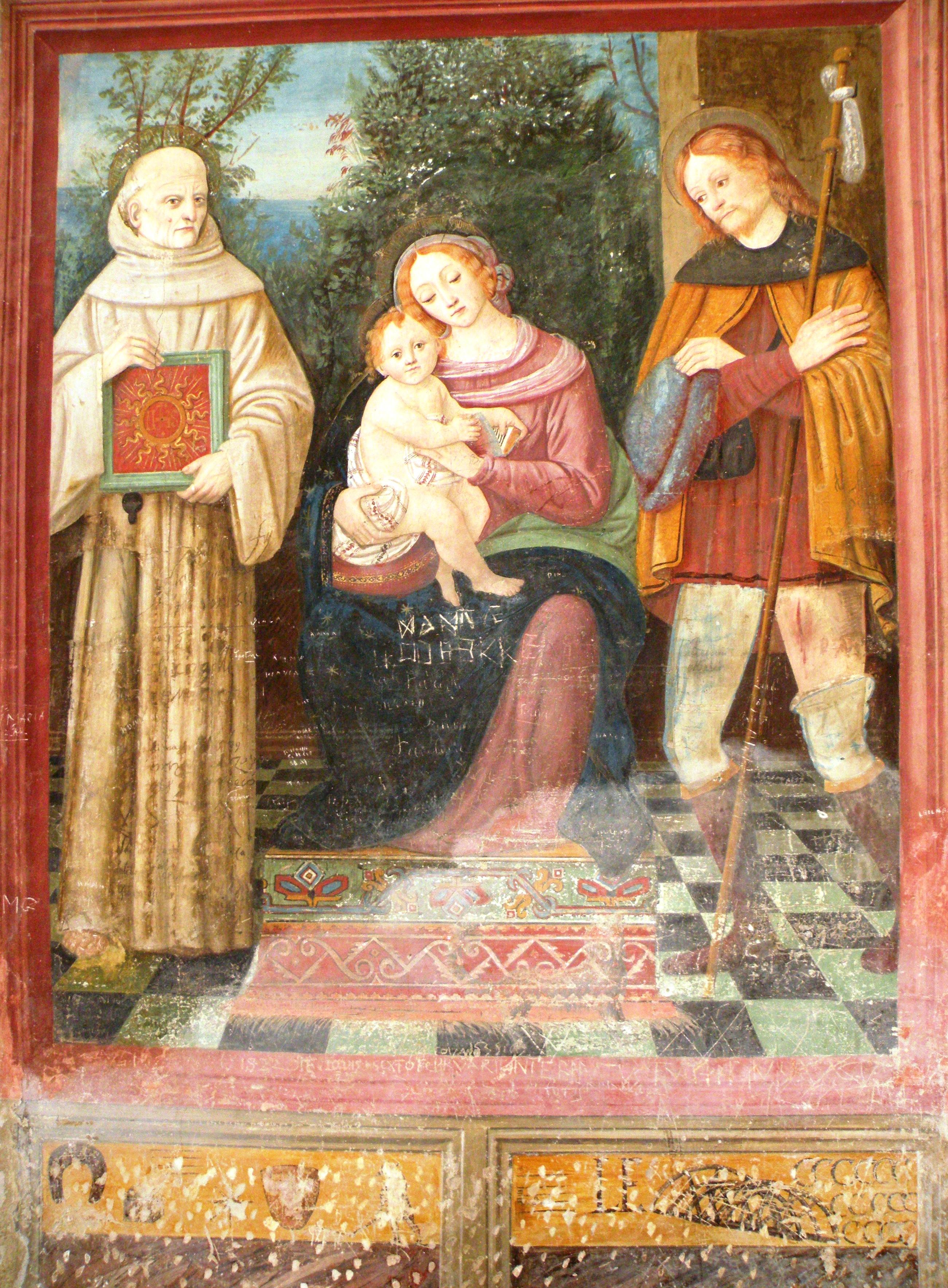 Fermo Stella, Madonna e Bambino tra san Bernardino da Siena e San Rocco, Caravaggio, Chiesa di San Bernardino, affresco. Nella parte inferiore del dipinto, alla base della finta cornice rossa la firma-rebus di Fermo Stella