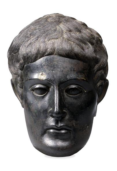 6.Parte anteriore di una testa maschile  375-350 AC (da un'isola del lago di Bolsena) bronzo, h 25,4 cm Londra, British Museum