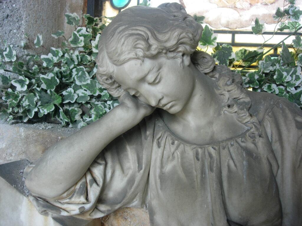 G. EMANUELI, Monumento Famiglia Castiglioni: La Mestizia, 1872, marmo di Carrara e Granito nero, basamento: h. cm. 72, l. cm.120, prof. cm 31; opera: h.cm.87, l.cm100, prof.cm.29  Castiglione Olona (Va), Cimitero, cappella Castiglioni