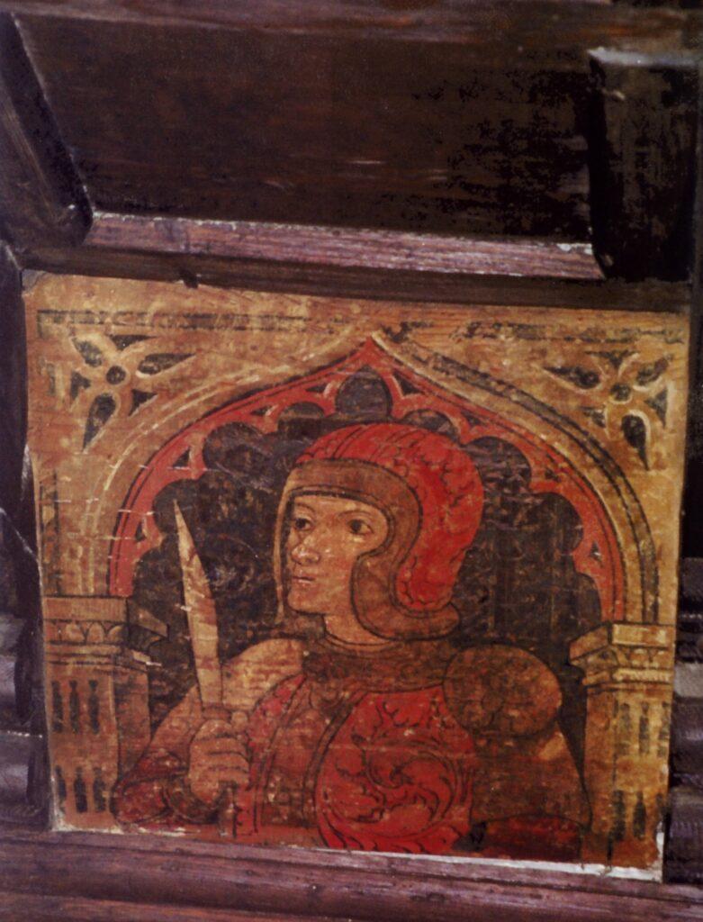 Uno splendido guerriero dipinto da una bottega bresciana nel settimo-ottavo decennio del XV secolo. E' interessante notare che l'arco a sesto acuto si riferisce ancora ad un orizzonte tardogotico, a dimostrazione di persistenze e miscidazioni tra lo stile arcaico e quello rinnovato dal confronto con la classicità