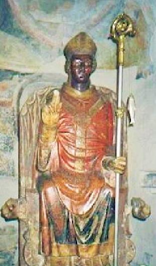 San Zen che ride, scultura, XII-XIII secolo, marmo rosso di Verona dipinto, Verona, Basilica di San Zeno. Recente l'apposizione del nuovo pastorale e del pesce