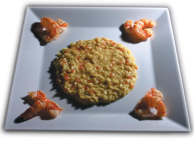 """Nella foto: il """"Riso mantecato al curry e pomodoro con code di gamberi saltati"""" di Gualtiero"""