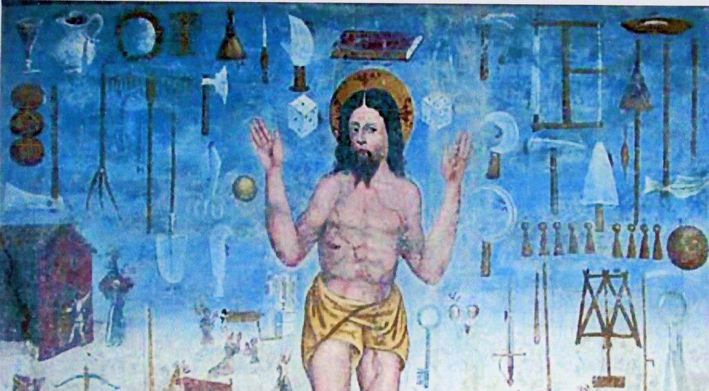 Cristo della Domenica (particolare), circondato dagli attrezzi che indicano le attività proibite nel giorno di festa. L''affresco è a Tesero nel Trentino