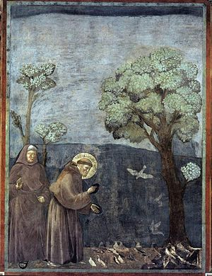 """Affresco attribuito a Giotto, Basilica di Assisi, La Predica agli uccelli è la quindicesima delle ventotto scene del ciclo di affreschi delle Storie di san Francesco della Basilica superiore di Assisi, attribuiti a Giotto. Fu dipinta verosimilmente tra il 1295 e il 1299. Misura 270x200 cm Questo episodio appartiene alla serie della Legenda maior (XII,3) di san Francesco: """"Andando il beato Francesco verso Bevagna, predicò a molti uccelli; e quelli esultanti stendevano i colli, protendevano le ali, aprivano i becchi, gli toccavano la tunica; e tutto ciò vedevano i compagni in attesa di lui sulla via."""""""