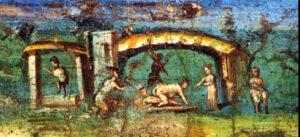 Scema nilotica, Casa dell'efebo, Pompei. L'artista, duemila anni fa, realizzò questo dipinto parietale che aveva il fine di rendere allegro ed eccitante l'ambiente. Il campo largo, la visione alla distanza, gli ampi spazi aperti e le macchiette si riallacciano alla pittura nilotica. A Paesi favolosi in cui fioriscono abbondanza e varietà di ogni specie. In questo contesto anche la sessualità umana esplode. L'artista dipinge così, al lambire di un porticato, non lontano da un fiume un uomo e una donna sul triclinio, nudi, mentre consumano un rapporto sessuale. La ragazza è probabilmente una danzatrice, come fa pensare la presenza di un'altra donna, in piedi e di una giovane che suona il flauto. Poco distante, ecco un servo che trasporta un contenitore di vino, evidente rievocazione dei poteri di Bacco su Venere